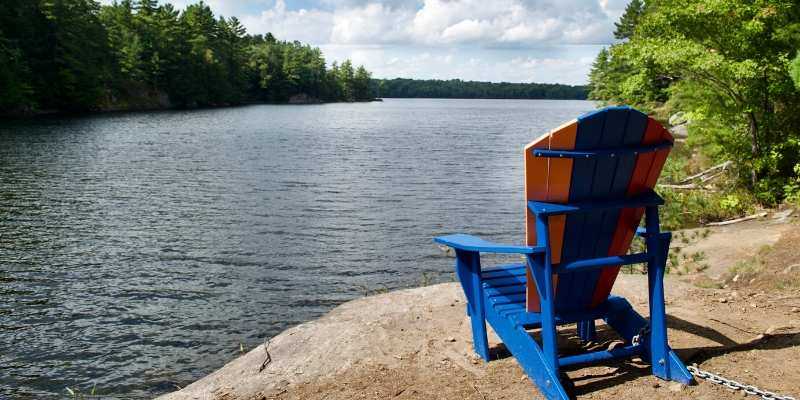 muskoka chair overlooking lake