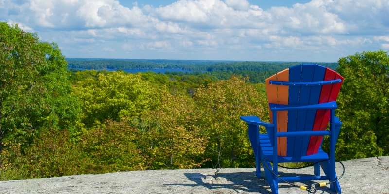 muskoka chair at top of rock lookout