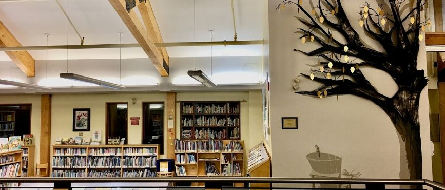 Giving Tree sculpture and quilt in the library in Port Carling